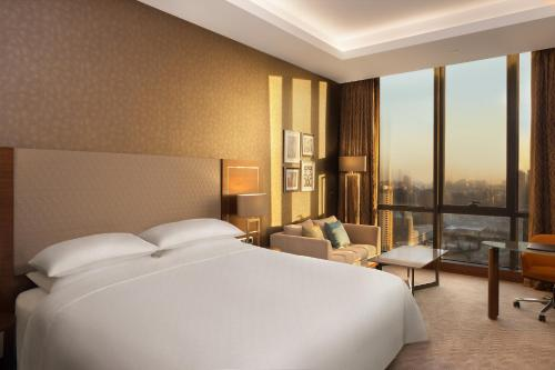 A bed or beds in a room at Sheraton Grand Istanbul Atasehir