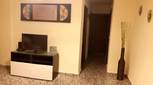 Una televisión o centro de entretenimiento en Apartamento Jose Maria Corona