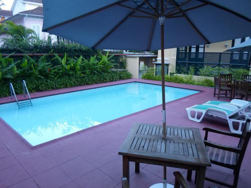 The swimming pool at or near Pousada Magister