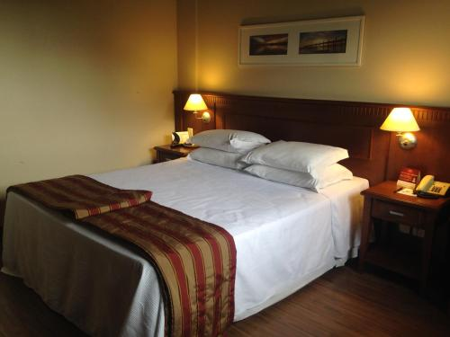 A bed or beds in a room at Flat Gramado Alpen