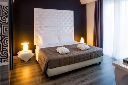 Ένα ή περισσότερα κρεβάτια σε δωμάτιο στο Hotel Da Vinci