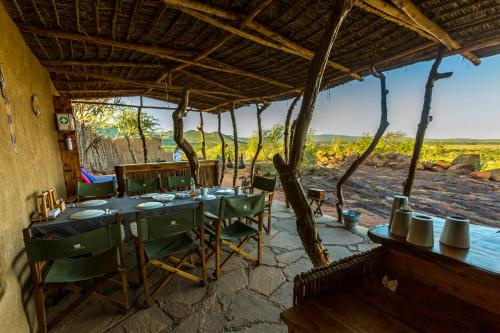 A restaurant or other place to eat at Maji Moto Eco Camp