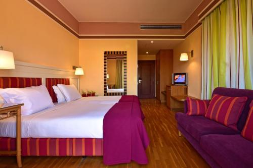 A bed or beds in a room at Pestana Sintra Golf Resort & SPA Hotel