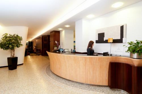 The lobby or reception area at Hotel Genova