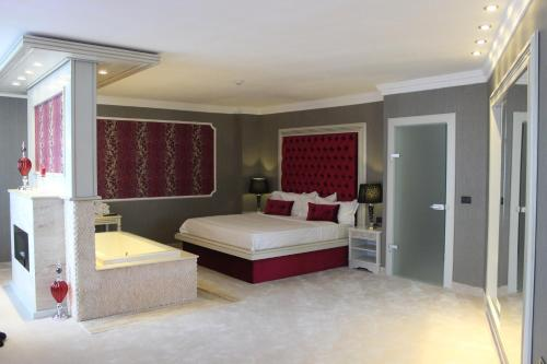 A bed or beds in a room at Phoenicia Grand Hotel