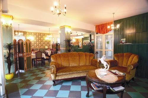 The lobby or reception area at Gondola Hotel