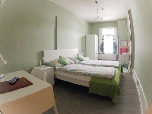Кровать или кровати в номере BasicRooms Hotel