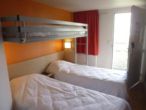 A bunk bed or bunk beds in a room at Premiere Classe Strasbourg Ouest