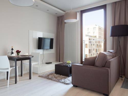 Część wypoczynkowa w obiekcie Chopin Apartments - City