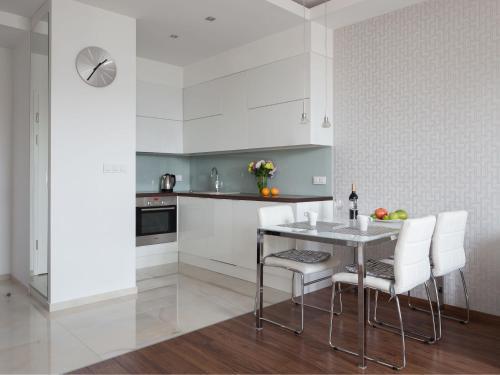 Kuchnia lub aneks kuchenny w obiekcie Chopin Apartments - City