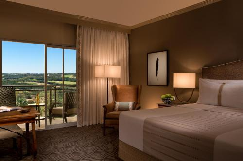A bed or beds in a room at La Cantera Resort & Spa
