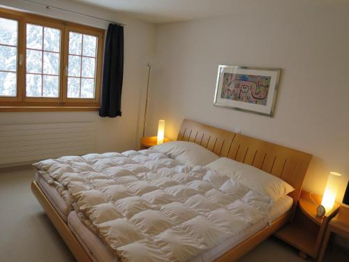 A bed or beds in a room at Chesigna 4