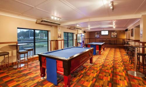 A pool table at Nightcap At Balaclava Hotel