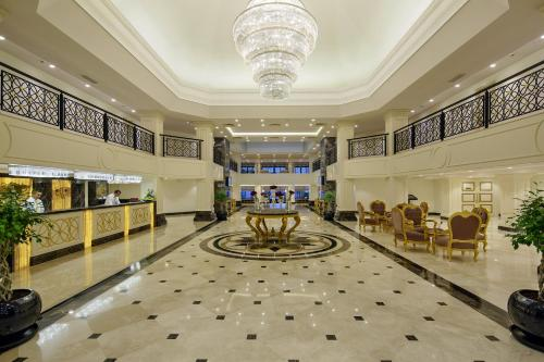 The lobby or reception area at Bellis Deluxe Hotel
