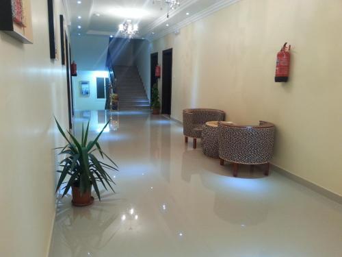 Uma área de estar em Lara Al Jawf Hotel Apartments