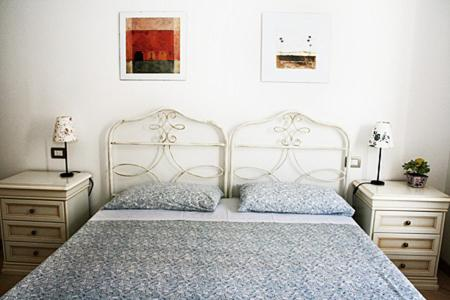 A bed or beds in a room at Residence Bizzoni