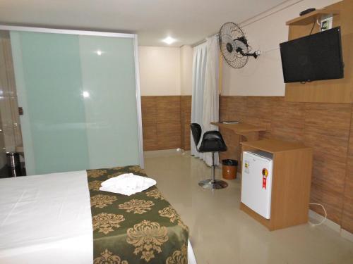 Телевизор и/или развлекательный центр в Hotel Pousada de Minas