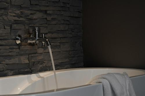 Een badkamer bij Hotel Le Bon Apart