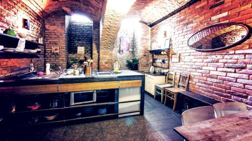 A kitchen or kitchenette at Sir Toby's Hostel