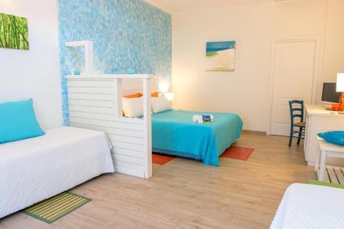 A bed or beds in a room at La Villa Del Mare