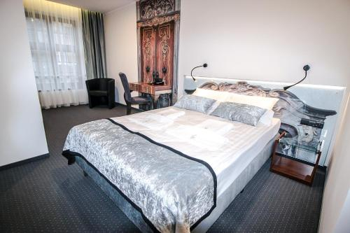 A bed or beds in a room at Celestin Residence