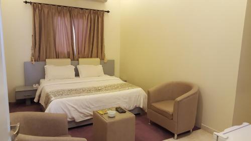 Cama ou camas em um quarto em Land Beach An Narjis