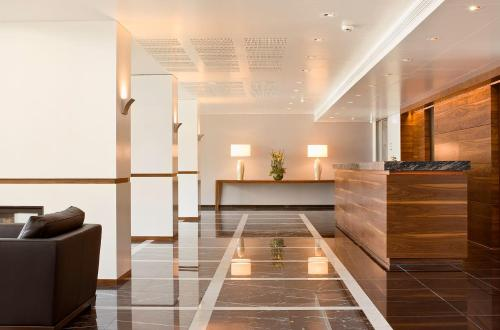 The lobby or reception area at Hotel Stadt Freiburg