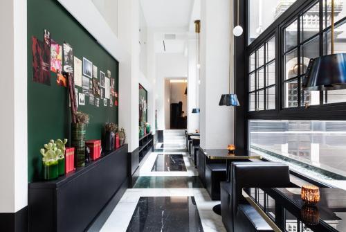 Un restaurante o sitio para comer en Senato Hotel Milano