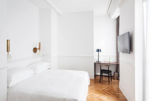 Cama o camas de una habitación en Senato Hotel Milano