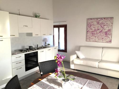 Кухня или мини-кухня в Residence Baco da Seta