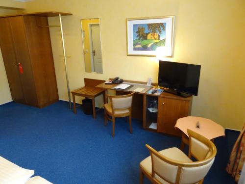 Ein Sitzbereich in der Unterkunft Hotel Restaurant Bootshaus