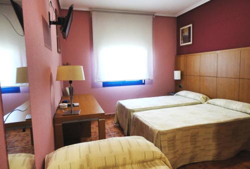 Cama o camas de una habitación en Hotel Mirador