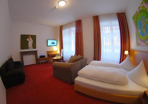 Телевизор и/или развлекательный центр в Hotel Mohren Post