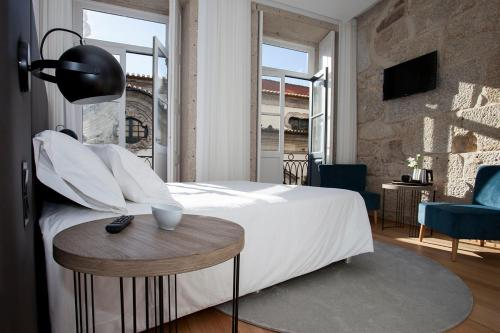 Een bed of bedden in een kamer bij Belomont52 Guest House