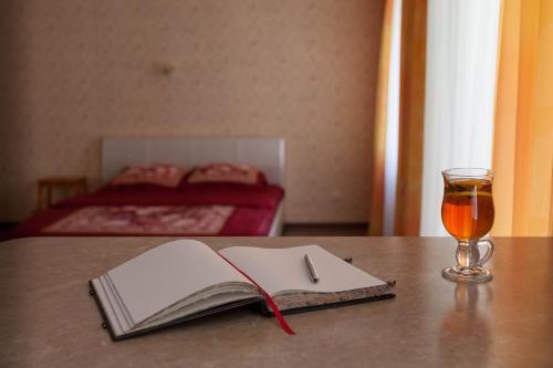 Кровать или кровати в номере Апартаменты-студио «На Печорской»