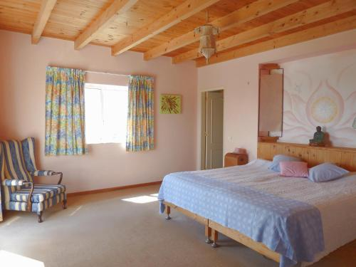 A bed or beds in a room at Highview Villa