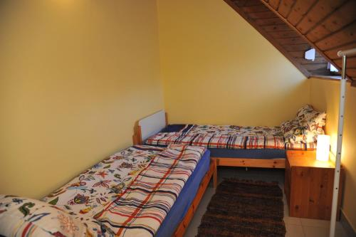 A bed or beds in a room at Csuka Vendégház