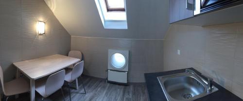 Ванная комната в Appart'hôtel Résidence CityZen