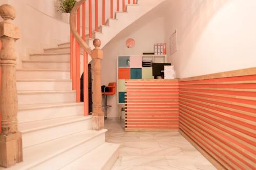 El vestíbulo o zona de recepción de Chinitas Urban Hostel