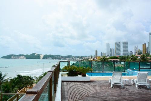 A balcony or terrace at Araçá Praia Flat