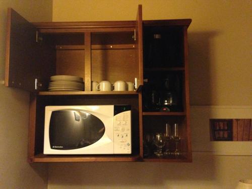 A kitchen or kitchenette at Flat Gramado Alpen