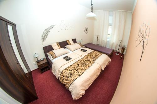 Кровать или кровати в номере Apartman Relax Olomouc