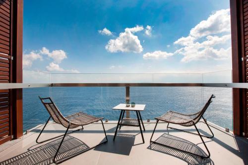 A balcony or terrace at Tui Blue Elounda Village Resort & Spa by Aquila
