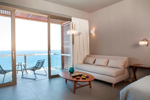 A seating area at Tui Blue Elounda Village Resort & Spa by Aquila