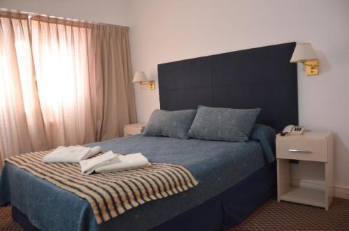 Una cama o camas en una habitación de Hotel Arenas