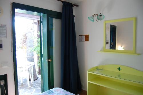 A bathroom at Hotel Club Torre Capovento