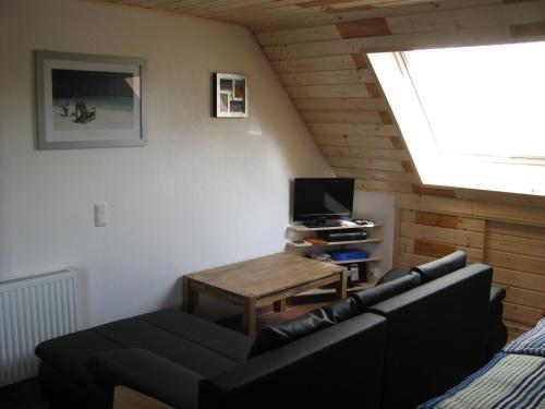 Ein Sitzbereich in der Unterkunft Ferienunterkünfte Boßmann