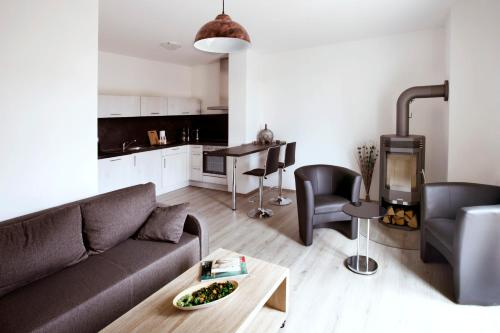A seating area at Leipzig Apartmenthaus