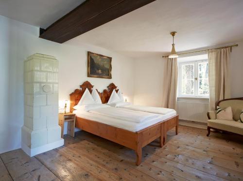 Ein Bett oder Betten in einem Zimmer der Unterkunft Ottmanngut Suite and Breakfast