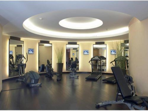 The fitness center and/or fitness facilities at Beau Rivage Hotel